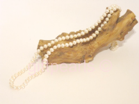 36 inch lustrous white pearl necklace.